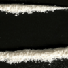 heroin mixed cocaine lined up on black background