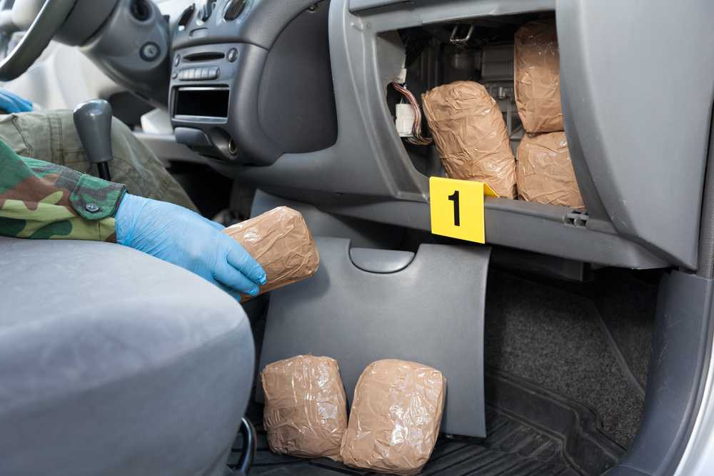 A car filled with hidden drugs being searched
