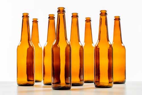 Several Empty Beer Bottles