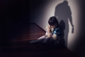 Sad child in the shadow of their parent