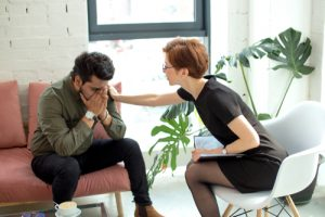 Therapist calming down a distressed client