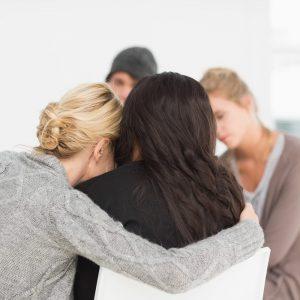 A group of friends huddled together talking
