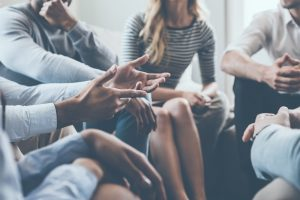 A circle of people in group therapy