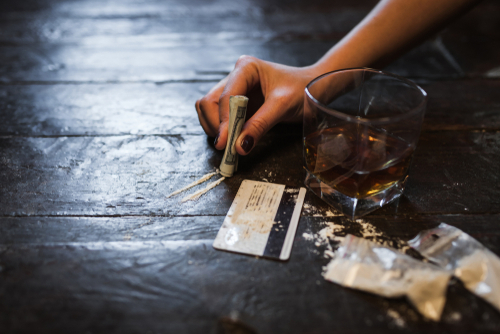 cocaine and whisky on a wooden floor