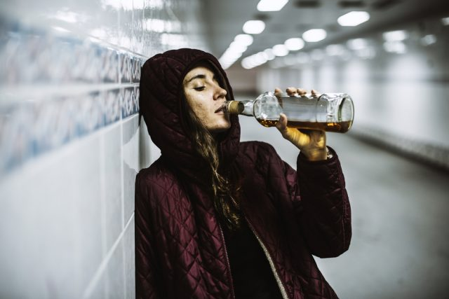 Woman at train station drinking