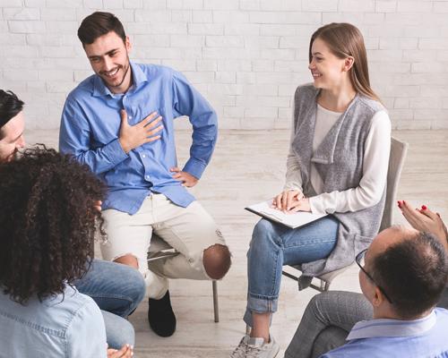 members in meeting speaking