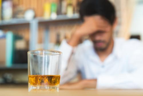 Sad man at the bar