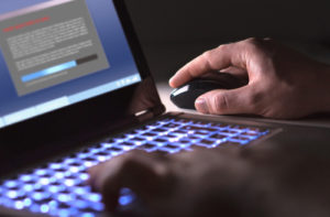 Close up of hands using a keyboard and mouse