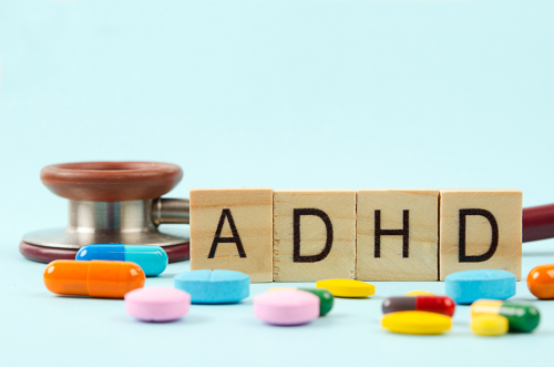 adhd written on wooden blocks