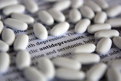 pills surrounding the word antidepressants
