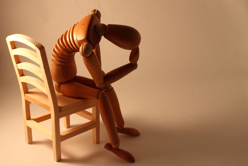 Depressed manakin in a chair