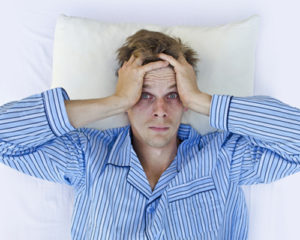 man-with-dark-circles-cannot-sleep-in-bed-from-meth-use-1