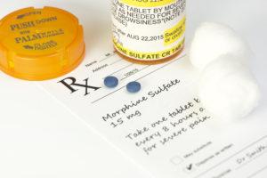 morphine pill bottle, pills, and prescription