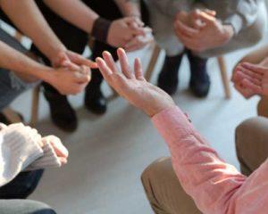 hands in meeting