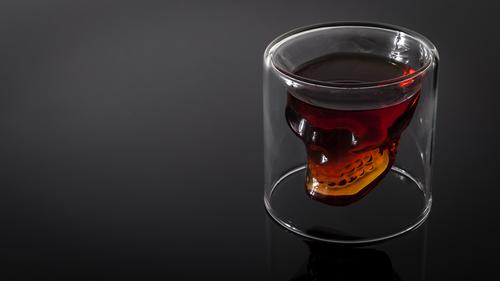 A whiskey glass shaped like a skull