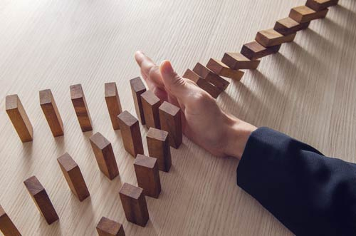 Hand in front of rows of falling blocks