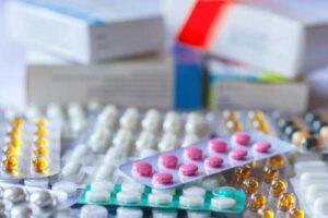 Various blister packs of pills in a pile