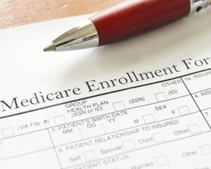 Medicare enrollment form and a pen