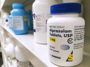 Alprazolam in a white bottle on a shelf