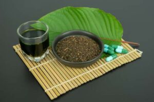 Kratom, in it's various forms on a bamboo mat.