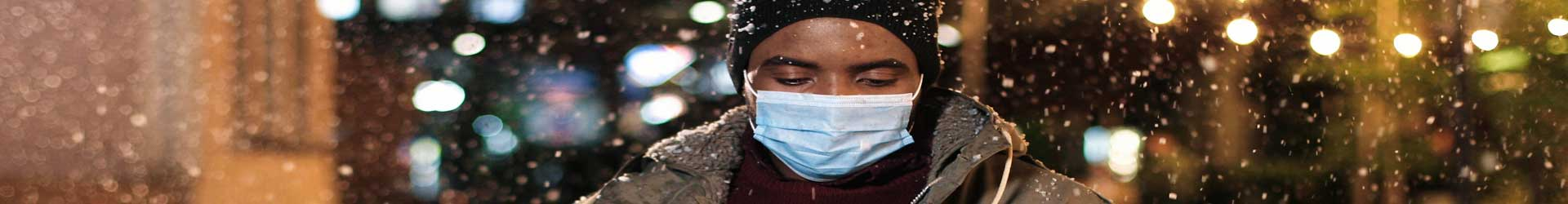 sad-man-outside-with-mask-on-during-quarantine-holiday-season